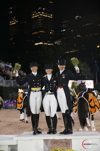 The top three in the Grand Prix Freestyle (L to R):  Tinne Vilhelmsen-Silfven, Judy Reynolds,  and Mikala Gundersen.