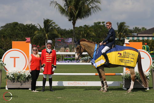Daniel Coyle and Simba de la Roque in their winning presentation with Hollow Creek Farm representative Jennifer Ward and ringmaster Steve Rector.