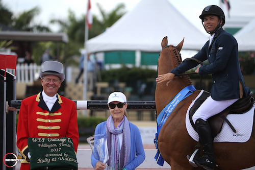 Kent Farrington and Creedance in their winning presentation with ringmaster Steve Rector and Laura Fetterman of Champion Equine Insurance.