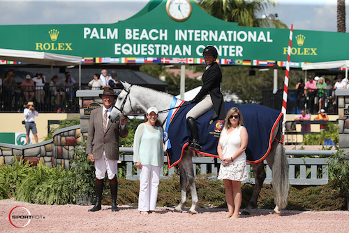 Winter Stroll and Nancy Hooker in their winning presentation with ringmaster Steve Rector, Carol Cone, and USHJA's Marla Holt.