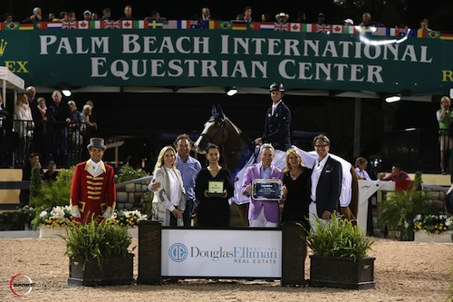 Ben Maher and Diva II in their winning presentation with ringmaster Gustavo Murcia, Katherine and Mark Bellissimo, Mounia Mechbal, Vice President of Communications, Rolex Watch USA, Michael Lauber, Dottie Herman, President and CEO of Douglas Elliman Real Estate, and Don Langdon, Palm Beach Broker, Douglas Elliman Real Estate