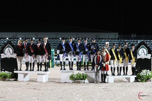 The top three teams on the podium with Carlene Ziegler of Artisan Farms and ringmaster Christian Craig.