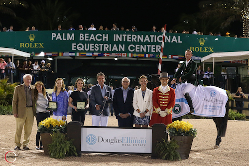 Richie Moloney and Carrabis Z in their winning presentation with father, Tom Moloney; Carrabis Z's owners, Diana and Jenji Mercer; Augusta Shifflett, Public Relations representative, Rolex Watch USA; Don Langdon, Managing Broker for Palm Beach & Wellington, Douglas Elliman; Howard Lorber, Chairman, Douglas Elliman; Nicole Oge, Chief Global Marketing Officer, Douglas Elliman; and ringmaster Christian Craig.